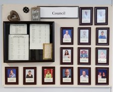 Bulletin board of Council member photos