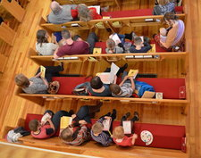 Many children in the pews at church