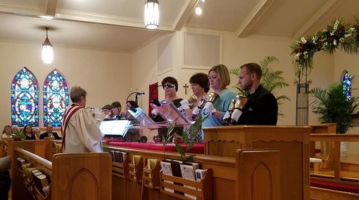 Handbell choir ringing on Palm Sunday