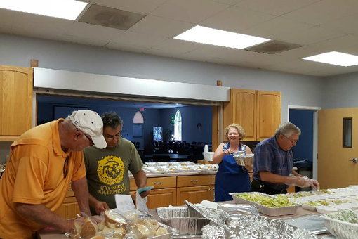 People preparing meals for the homebound
