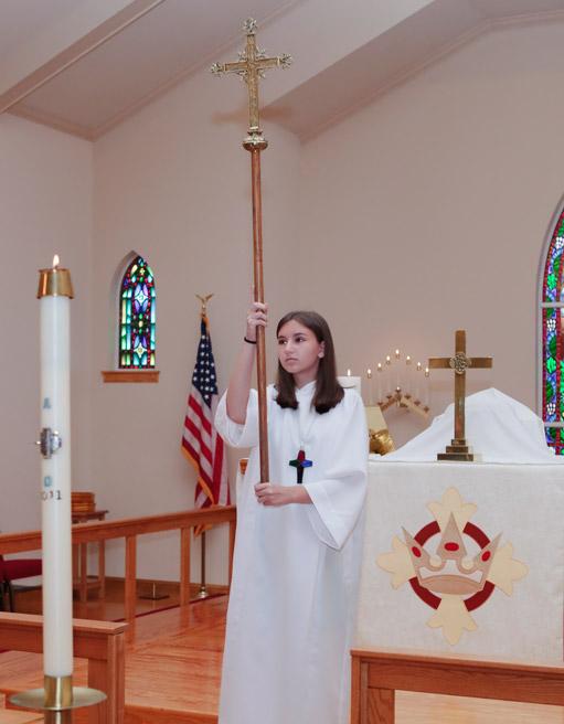 Alter girl carrying cross