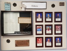 Bulletin board with Elders photos