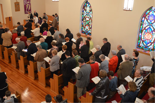 The congregation standing and singing